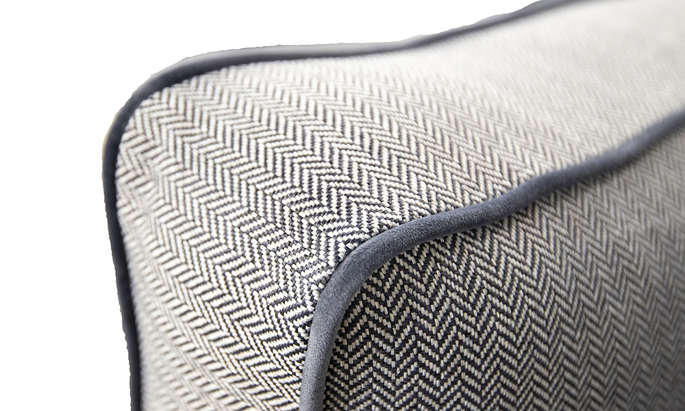 Back Cushion Detail in Porto Charcoal, Contrast Piping in Luxor Tempest, Silver Collection Fabric