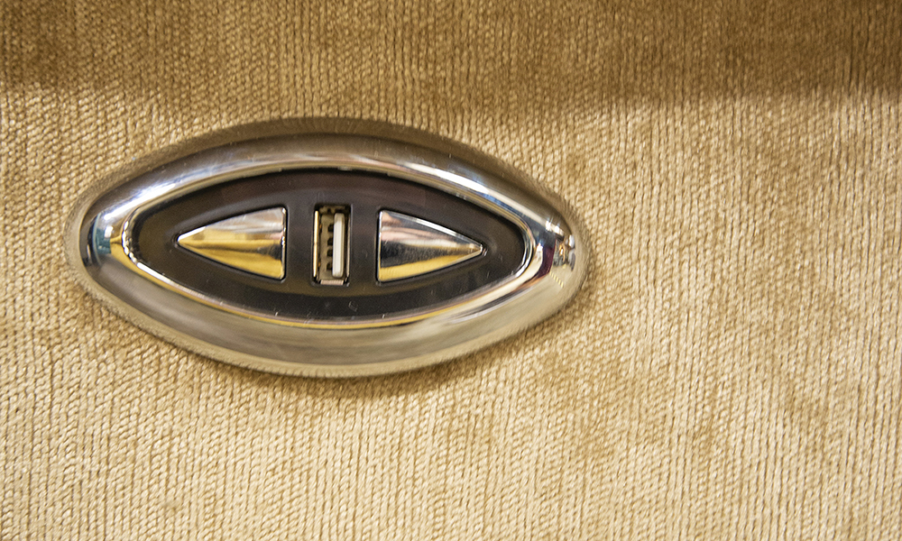 Greville Recliner Chair Button/USB detail in Edinburgh Biscuit, Silver Collection of Fabrics