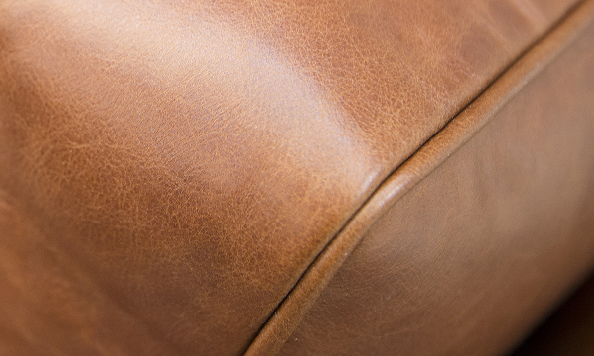 Leather-Nolan-4-Seater-Chaise-End-Sofa-close-up-in-Mustang-Rust